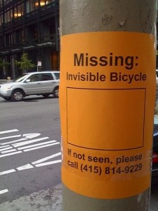 "signpost saying ""missing invisible bicycle"""